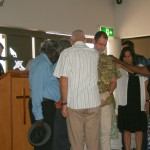 Laying of hands on Stuart McMillan